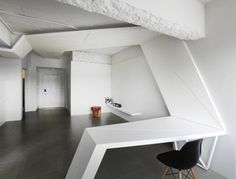 Continuous Element transforms from a ceiling canopy to a wall cladding to a furniture.