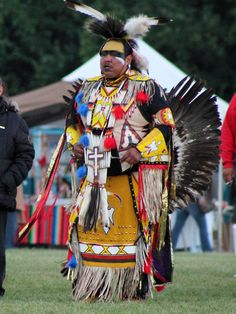 Man wearing his pow wow regalia at the American Indian Center of Chicago's Pow Wow