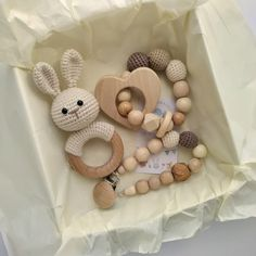 This neutral bunny gift box willl be a perfect baby shower, postpartum baby gift or unique gift for coworker! Gift wrap is included and consists of the toy, white box, card and tissue paper. You can choose teether shape on the bracelet. Baby Gift Box, Baby Gifts, Gifts For Coworkers, Gifts For Mom, Baby Easter Basket, Tactile Stimulation, Newborn Essentials, Pacifier Holder, Soft And Gentle