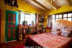 San Miguel de Allende, Guanajuato, Mexico: The guest bedroom of the eclectic home of Anado McLauchlin and his husband Richard Schultz also uses a bright pallate and global art. June 2009. (photo: Ann Summa)..
