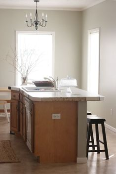 This is my goal for now. Paint the walls and leave the cabinets until I decide what I want to do with them. Love the color, Sedate Gray