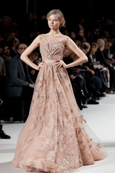 Elie Saab, loved by young Hollywood starlets, such as Kristen Stewart and Dakota Fanning, created a show reminiscent of a romantic fairytale. The fluidity of his dresses inspired a breathtakingly ethereal setting. The goddess-like models floated down the runway adorned in delicate lace, billowy chiffon and elegant embroidery.