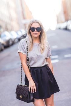 Linda Juhola in black Missguided skirt, grey t-shirt by Kjær København, Celine sunglasses and Chanel bag