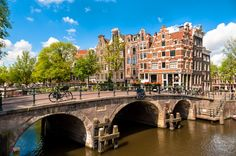 Amsterdam Leaning Buildings and Canals jigsaw puzzle in Bridges puzzles on TheJigsawPuzzles.com