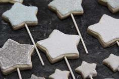 Sugar cookie stars on a stick. Could be wand favors for a fairy princess party!