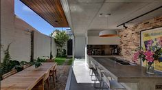 Long Courtyard House is a contemporary addition to a turn of the century terrace house designed in 2013 by SCALE Architecture, located in Alexandria, a suburb in the inner-east of Sydney, New South Wales, Australia. Küchen Design, Patio Design, House Design, Design Ideas, Indoor Outdoor Kitchen, Outdoor Rooms, Outdoor Living, Outdoor Kitchens, Concrete Kitchen