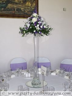 Use at buffet table with different heights if platters of food.  Tall Purpleflower  Wedding Reception Centerpieces