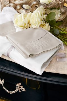 The best luxuries are personal. Monogrammed sateen bedding from Ralph Lauren Home.