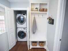 Stacked washer and dryer in entryway closet