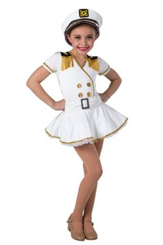 Style# 17465 CAPTAIN OF THE SEA  White spandex leotard with black spandex inserts. Separate matching skirt with white fantasy spandex waistband and white chiffon ruffled underskirt. Gold sequin braid, fringe, sequin disc, star applique and rhinestone buckle trim. Headpiece included. XSC-XXLA