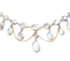 Edwardian Festoon Necklace of Moonstone 1450$ Absolutely in love with this necklace. :( Mommy's engagement ring is moonstone. Would be a nice nod to that...