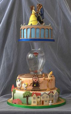 Beauty and the Beast wedding cake. So. Adorable! I would need more of the library though!