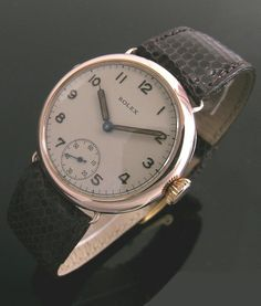 An early 9ct rose gold round vintage Rolex watch, 1928
