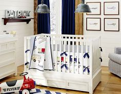 Boys transportation themed nursery with cars, trucks, and trains