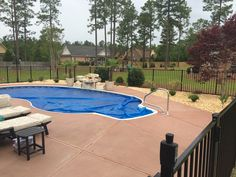 Parrot Bay Pools and Spas Vinyl Swimming Pool Kidney shaped Pool Colored Concrete Rock Waterfall