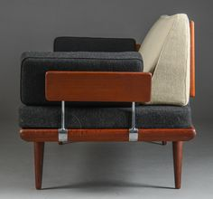 Peter Hvidt sofa.  Example of mixing solid fabrics (we would do your concept colors, not these)