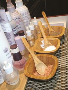 SpaRitual's bamboo containers house scrubs and masks. Products rest on a bamboo tray on every manicure table. www.nailsmag.com