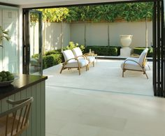 Stonemarket from inside to outside stunning paving. Natural stone paved kitchen and garden.