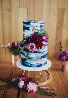 Beautiful Unique Wedding Cake for your fall/spring upcoming wedding. Love the blue marbel look and the flowers!