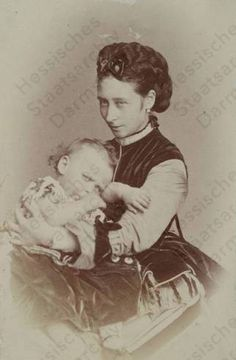 Alice with her son Frittie. She may almost be smiling here.