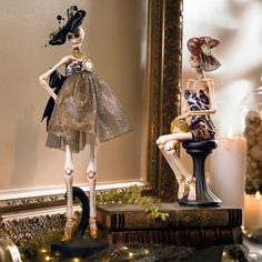 Shockingly svelte and sporting the latest in haunt couture, our Fashionista Skeletons would be right at home on a Paris runway, but they're most    comfortable as stars of your Halloween d. From the imaginative mind of beloved collectibles artist Mark Roberts. Standing model wears a    scandalously short, sparkly tulle, baby-doll dress. Out-of-this-world hat, pearl necklace, black bow at the waist, and gold high-heels complete her    ensemble. Sitting figure wears a velvet, leopard-print ...