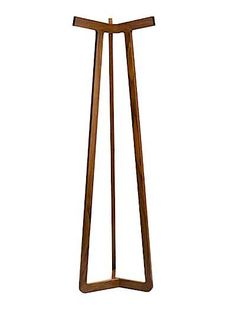 Modern coat rack. The Stretch Coat Rack by Milwaukee-based Misewell Modern Furniture is made of American walnut with pinwheel joinery connecting the three identical segments.