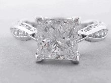 Discover our delightful 2.83 ctw Diamond Engagement Ring as it rotates with an elegant 2.20 ct F color/SI2 clarity, Clarity Enhanced Princess Cut center diamond. It has a beautiful, unique setting laden with over a half carat of diamonds in a sleek infinity style. Check out more on our website! Princess Cut Rings, Princess Cut Diamonds, Diamond Rings, Diamond Engagement Rings, Diamond Girl, Unique Settings, Jewelry Rings, Jewellery, Diamond Shapes
