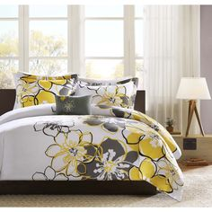 For a fresh look, this Allison duvet cover set can brighten up your room with its vibrant yellow flowers and corresponding shams. Duvet cover and shams reverses are dark grey for a great background for the bright yellow flowers.