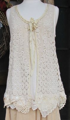 Handmade crochet vest with vintage laces and ribbons. So feminine.