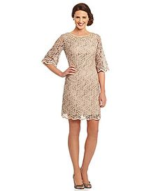 Adrianna Papell Bell-Sleeve Scalloped Lace Sheath Dress @ Dillards but would need to bling it out with some jewelry.