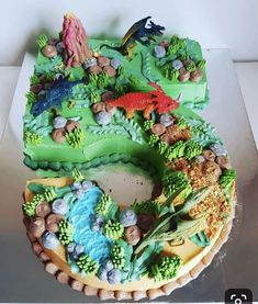 Dinosaur Number Cake Get inspiration for your Dinosaur Birthday Cake, Gallery of the best Dinosaur c The Good Dinosaur Cake, Dino Cake, Dinosaur Cupcake Cake, Dinosaur Cakes For Boys, T Rex Cake, Dinosaur Dinosaur, Dinotrux Cake, Le Voyage D'arlo, Dinosaur Birthday Cakes