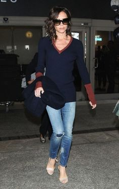 Victoria Beckham Ripped Jeans - Victoria Beckham kept it youthful and edgy in a pair of distressed jeans.