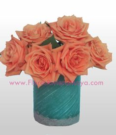 #Coral and teal #wedding #centerpiece #weddingFlowers Http://www.floresrivieramaya.com