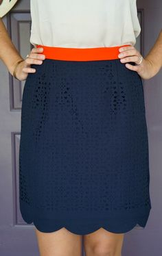 I love EVERYTHING about this skirt- the scallop trim, orange waistband, cut out detail, navy blue color, and length!