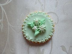 Hand-painted flower medallion sugar cookie in Mint