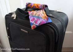 Make a cute gift for Dads or Grads by recycling old neckties into luggage handle cozies and luggage tags! They'll never wonder if it's their bag again!