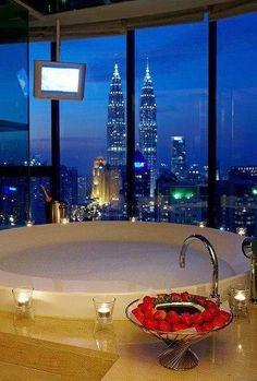 Relax in a tub with a view and champagne , strawberries and chocolate don't hurt..