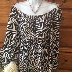"""Slinky Brand Zebra Shark Bite Tunic &Pant Set NWOT Both pieces are 95% polyester and 5% spandex.  Shark bite tunic can be wore off the shoulders.  Hem is 33"""" in length at the longest part of the shark bite top. Colors black and white.  When laid flat and measured from armpit to armpit it is 19"""" across with a lot of stretch. Elastic under the bust line.  Flows beautifully. The pants are white with an elastic waist and are slightly sheer!   Inseam is 28"""".  To me this brand runs big, more like…"""