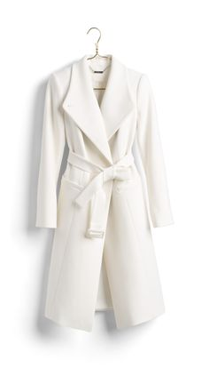 SPONSORED: A White House Black Market wide lapel coat is the must-have luxe layer to own this winter. An elegant update to the classic coat, wear this dramatic, draped lapel style open over monochromatic layers. Or button it up and top everything from dresses to your best-loved jeans.