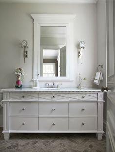 Bathroom vanity and herringbone tiles