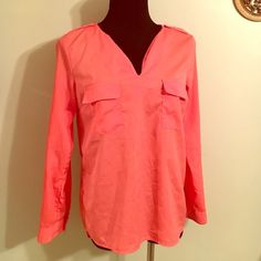 EUC coral long sleeve semi sheer Montana top small Extremely beautiful soft sheer top by Montana, sleeves can be rolled up unbuttoned to make it quarter sleeves. Longer in the back shorter in the front . A high-low top. Size small two pockets in the front button.co on the shoulder V neck line! This will go gorgeous with so many things and the color coral is just stunning for spring and fall alike! Thank you so much and enjoy! Montana Tops Blouses
