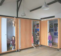a mini rolling cube per kid. privacy for sleeping. shared play area. Great idea