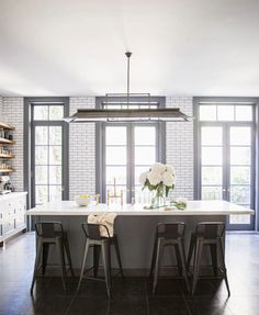 gorgeous kitchen - love the subway tiles and stools