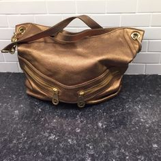 Gorgeous MK Gold Leather Hobo Awesome purse, inside is flawless. Little wearing of leather on back ( see pics).   Heavy gold hardware with removable shoulder strap!Z#0220 Michael Kors Bags Hobos