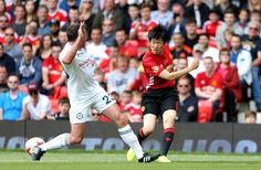 Carrick AllStars' Jamie Carragher and Manchester United's Ji Sung Park battle for the ball during Michael Carrick's Testimonial match at Old Trafford...