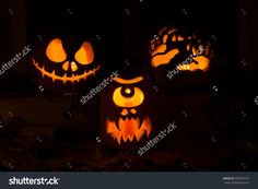 Photo Composition From Three Pumpkins For Halloween. Jack, A Cyclops And Hands Of Pumpkin Against Autumn Leaves And Candles - 330107516 : Shutterstock