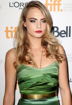 One of the loveliest looks at TIFF: red lips and smoky eyes on  Cara Delevingne. http://beautyeditor.ca/2014/09/15/cara-delevingne-tiff-2014