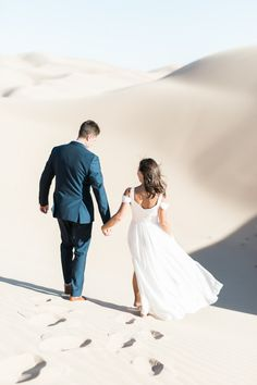 Walking through the sand dunes together: http://www.stylemepretty.com/little-black-book-blog/2017/02/03/epic-sand-dune-engagement/ Photography: Alex Warschauer - https://www.alexwphotography.com/