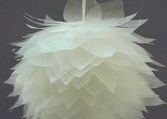 http://www.carolynshomework.com/2011/07/inkling-lotus-blossom-pomander-ball.html