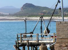 Elands Bay is a town in South Africa, situated in the Western Cape Province, on the Atlantic Ocean.  Small Fishing Harbour